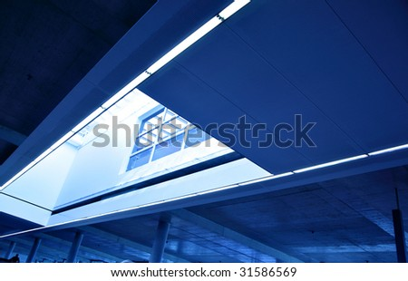 Wide angle shot of modern interior with skylight window - stock photo