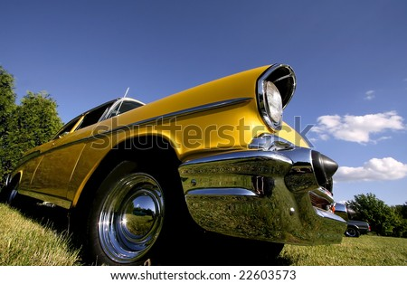 Wide angle shot of yellow classic car - stock photo