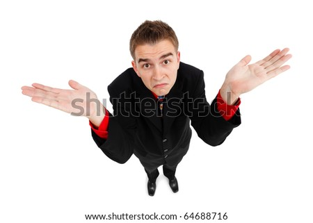 Wide angle top view of a young man showing don't know gesture - stock photo