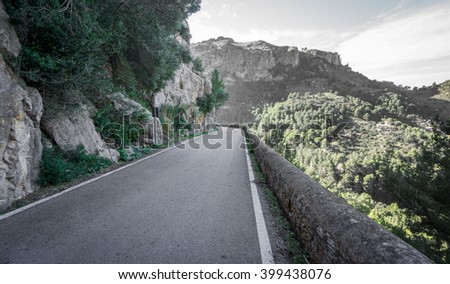 Wide angle view mountain road - stock photo