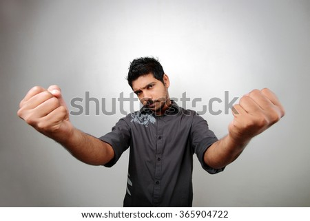 Wide angle view of a man showing his closed hands. - stock photo