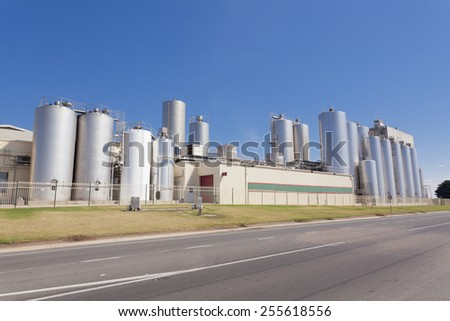 Wide angle view of a typical cheese factory - stock photo