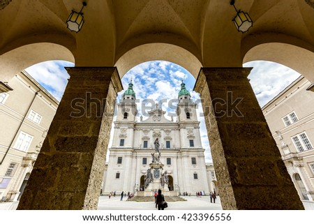 Wide-angle view of famous historic Salzburg Cathedral and Maria Immaculata column at Domplatz square in spring, Salzburg, Austria - stock photo
