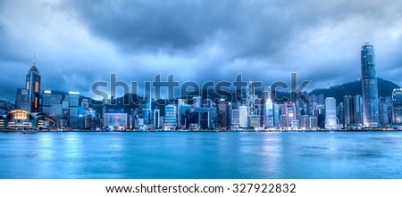 Wide-angle view of Hong Kong skyline on Victoria Harbor taken at the blue hour after sunset. Viewed from downtown Tsim Sha Tsui on Hong Kong Island. HDR rendering.