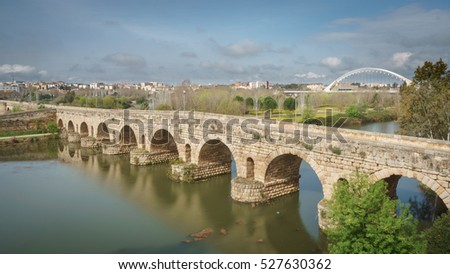 Wide angle view of Roman bridge over Guadiana river in Merida, Spain