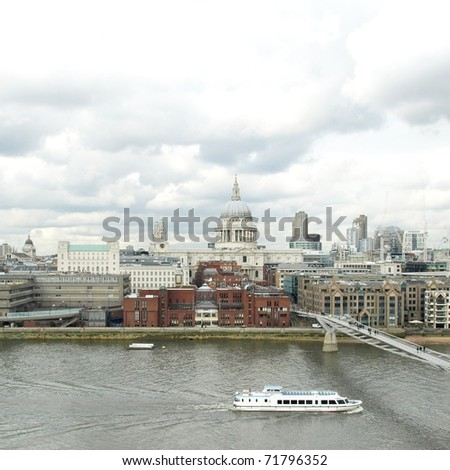 Wide angle view of Saint Paul's Cathedral in the City of London, UK under a typica British rainy weather - stock photo