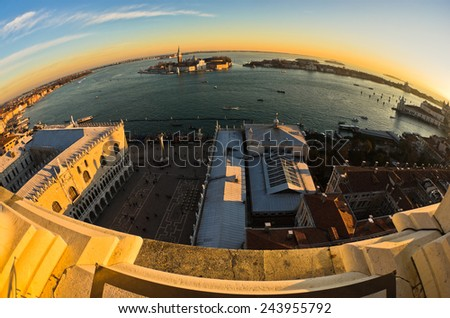 Wide angle view of sunset in Venice, piazza San Marco, Doges palace, Grand Canal and San Giorgio Maggiore church in background, Italy - stock photo