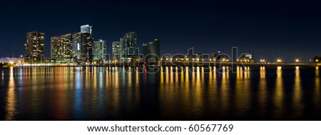 Wide angle view of the Venetian Causeway Drawbridge and Biscayne Bay in Downtown Miami in the late evening with colored reflections on the bay. - stock photo