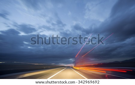 Wide angle view of truck driving during night, blurred motion - stock photo