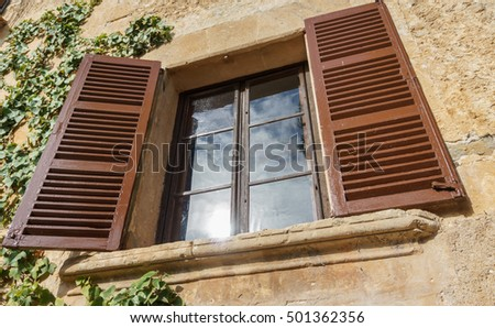 Wide angle view of vintage window in Old Stone Wall