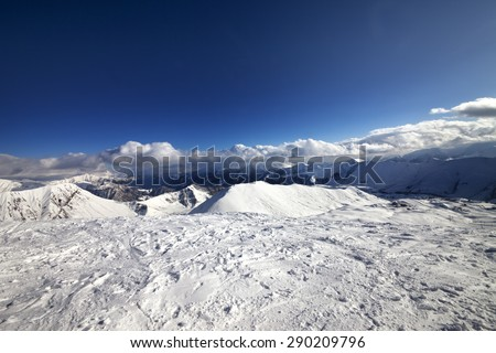 Wide-angle view on off-piste slope and snowy mountains. Caucasus Mountains, Georgia. Ski resort Gudauri. - stock photo