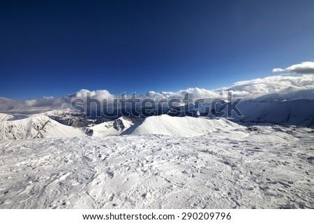 Wide-angle view on off-piste slope and snowy mountains. Caucasus Mountains, Georgia. Ski resort Gudauri. - stock photo
