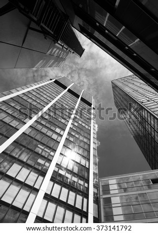 Wide angle view to steel high building skyscrapers in modern futuristic downtown.Concept of successful industrial architecture  - stock photo