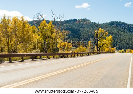 Wide asphalt mountain road in beautiful sunny autumn, Colorado, USA
