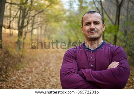 Wide closeup of a man with stubble outdoor in the forest