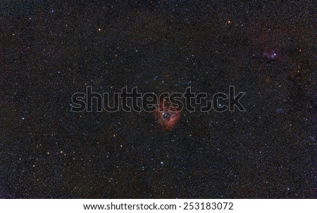 Wide Field View of the Rosette Nebula and the Christmas Tree Cluster - stock photo