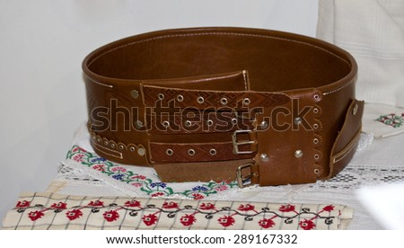 Wide leather belt brown for Moldovan national costumes - stock photo