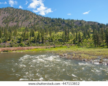 Wide Mountain River Cuts a Valley - Clark Fork River Montana USA - stock photo