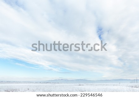 Wide open sky and hoar frost covered farmland. Countryside in North Idaho during frigid winter weather.  - stock photo