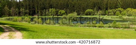wide panorama, Beautiful summer rural landscape with small lagoon. Rural landscape with pond. Spring landscape. Green czech countryside. Beautiful highland vysocina european countryside - stock photo