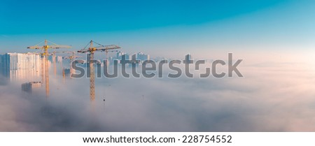 Wide panorama of foggy urban scene Thick fog in the morning covering a residential district. Kiev. Ukraine.  - stock photo