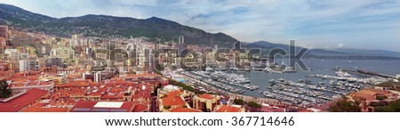 Wide panorama of Monaco, French Riviera. View on Mediterranean sea, yachts and buildings - stock photo
