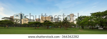 Wide panorama of Nairobi downtown area, populated shot with business names removed - stock photo