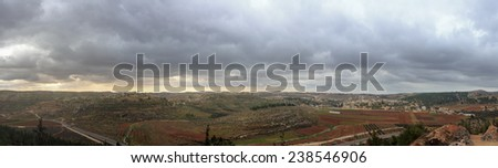 Wide panorama of Palestinian villages al'Alaqa al Fawqa and Rabud  before the storm in Judea at Har Hebron - stock photo