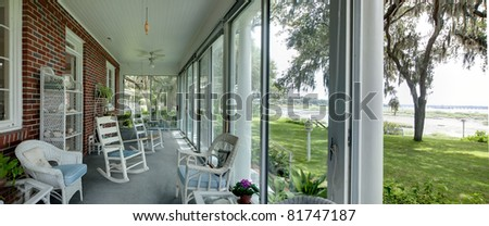 wide panorama of porch with sea view - stock photo
