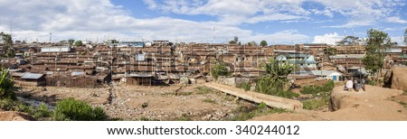 wide panorama of the Kibera slum, largest urban slum in Africa - stock photo