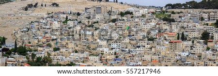 Wide panorama of the urban neighborhoods of East Jerusalem, Israel