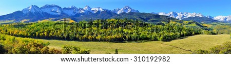 wide panoramic view of the alpine scenery of Colorado during foliage season - stock photo
