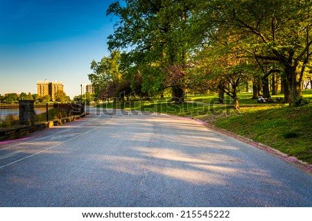Wide paved path at Druid Hill Park, Baltimore, Maryland. - stock photo