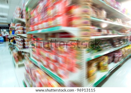Wide perspective of supermarket aisle - stock photo
