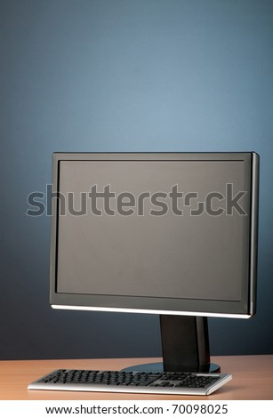Wide screen computer monitor against colorful background - stock photo