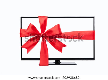 wide screen tv monitor tied with red ribbon isolated on white - stock photo