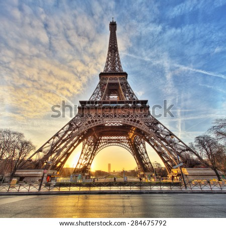 Wide shot of Eiffel Tower with dramatic sky, Paris, France - stock photo