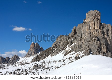 wide snowed valley with snowed mountains in the distance - stock photo