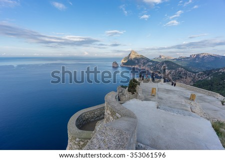 Wide view of Cape Formentor viewpoint with blurred tourists and coastline in Mallorca