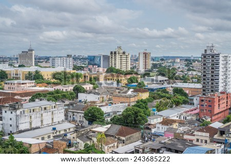 Wide view of colorful houses and cloudy sky in old town, Manaus - stock photo