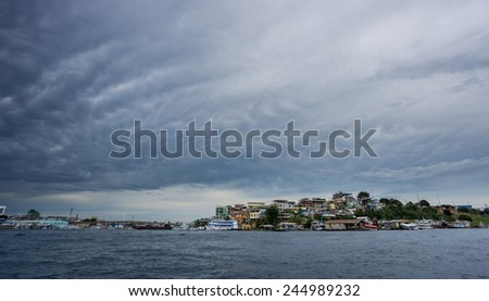 Wide view of colorful houses and stormy clouds in old town, Manaus - stock photo