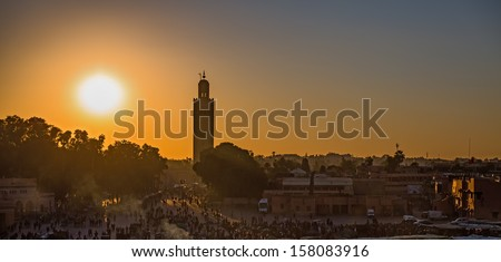 Wide view of Koutobia mosque at sunset, backlit in Marrakesh