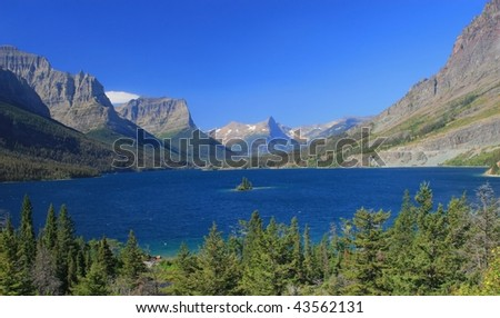 Wide view of St. Mary Lake from Sun Point viewpoint off Going to the Sun Road in Glacier National Park, Montana - stock photo