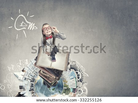 Wideangle picture of funny schoolgirl with paper plane. Elements of this image are furnished by NASA - stock photo