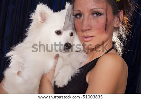 Widowed woman in black and white dog
