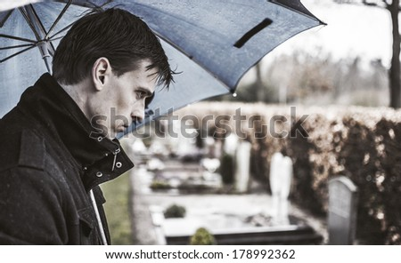 Widower visiting grave. Emotional of loss - stock photo