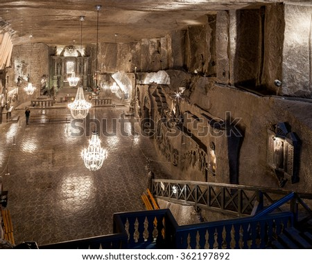 Wieliczka - Poland - April 23. Tourists walk down to main Wieliczka Mine Salt Museum attraction - St. Kinga Chapel located 101 meters underground. Wieliczka - Poland - April 23, 2015