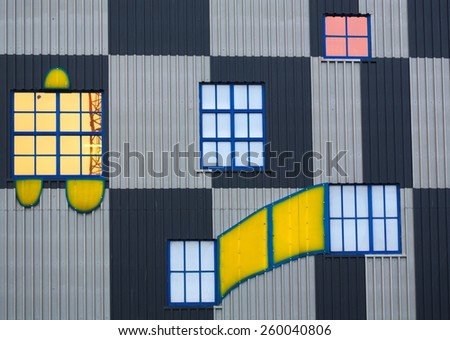 WIEN, AUSTRIA, JANUARY 4, 2015: detail of windows and colorful facade of the famous waste incinerator designed by friedensreich hundertwasser in spittelau, wien. - stock photo