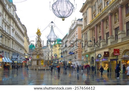 WIEN, AUSTRIA, JANUARY 4, 2015: people are passing by through graben street where the most luxurious shops in wien are situated. - stock photo