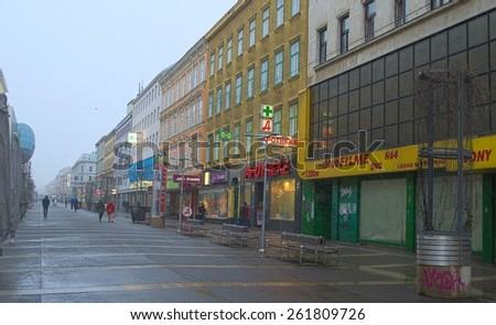 WIEN, AUSTRIA, JANUARY 4, 2015: People are walking through favoritenstrasse boulevard in wien, where heavy snow storm hits many shops. - stock photo
